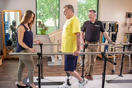 Physical therapy - man with prosthetic leg walking